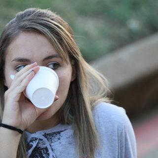 Une jeune femme qui boit dans un verre et regarde de côté (illustration) - 'untitled' http://www.flickr.com/photos/31810320@N05/5011595055 Found on flickrcc.net